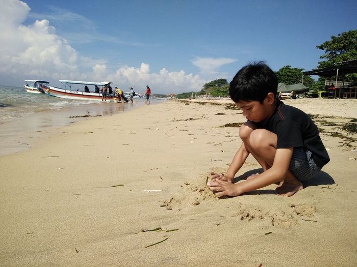 Beach Casual Clothing Coastline Day Enjoyment Full Length Leisure Activity Lifestyles Nature Outdoors Relaxation Sand Sea Shore Sky Summer Sunlight Tourism Tourist Vacations Water Tanjungbenoa Bali, Indonesia Nusadua