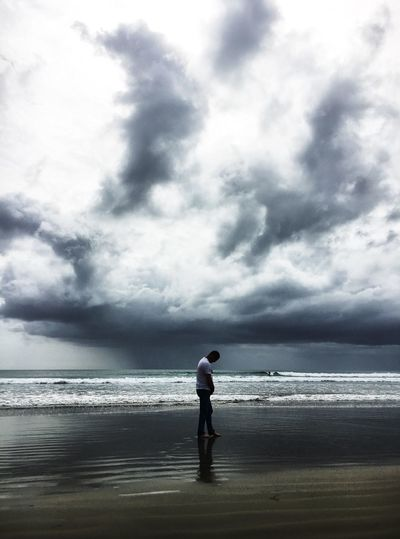 Micro burst over 90 mile beach Sea Water Horizon Over Water Sky Full Length Standing One Person Scenics Beauty In Nature Beach Nature Cloud - Sky Real People Tranquility Tranquil Scene Leisure Activity Day Vacations Men Outdoors
