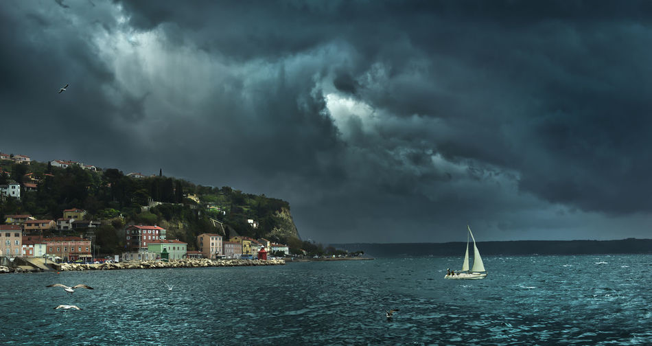 a sailboat in front of the city of Piran, during a summer storm Coastline Architecture Beauty In Nature Building Building Exterior Built Structure Cloud - Sky Coast Nature Nautical Vessel No People Outdoors Overcast Power In Nature Sailboat Sea Sky Storm Storm Cloud Water Waterfront