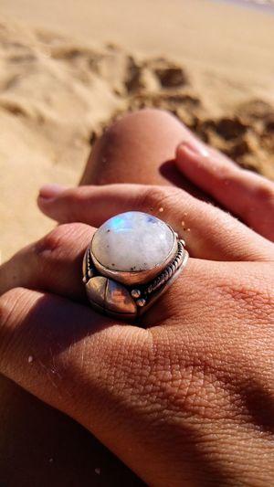 Close-up of woman wearing ring at beach
