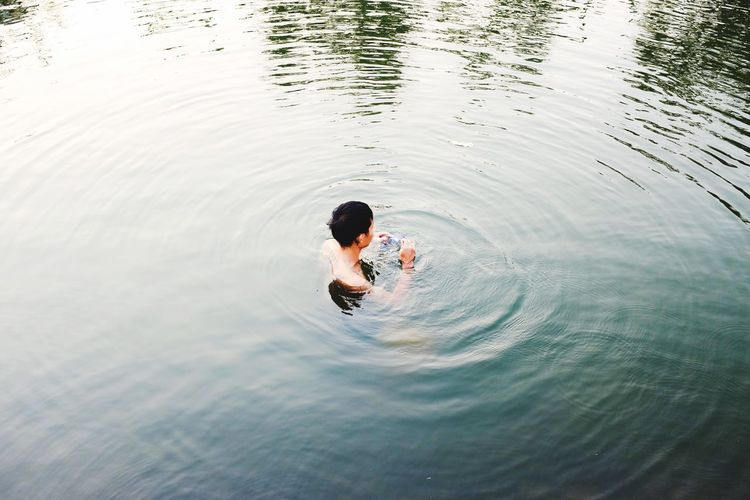 EyeEm Selects Yakuza bathing in old town moat. Chiangmai, ThailandYakuzaa Moat Old City Moat Chiang Mai | Thailand Chiangmai Man In Water Man In Moat
