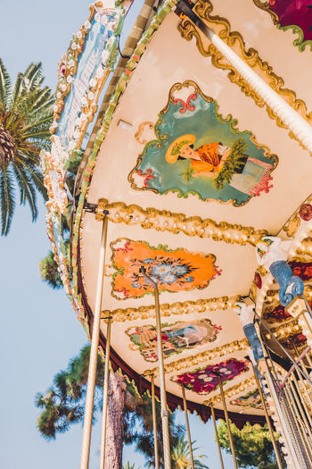 Creativity Art And Craft Representation Low Angle View Human Representation Belief Sculpture No People Religion Spirituality Amusement Park Sky Nature Plant Amusement Park Ride Architecture Day Tree Statue Built Structure Outdoors Ornate Carousel Carousel Horses