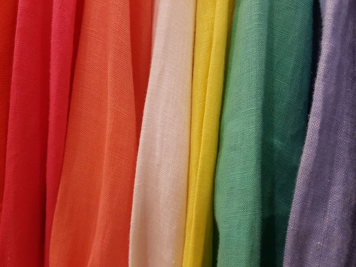 Close up of colorful linen. Linen Multi Colored Backgrounds Full Frame Textured  Textile Retail  Variation Choice Fashion In A Row Fabric Retail Display Colorful