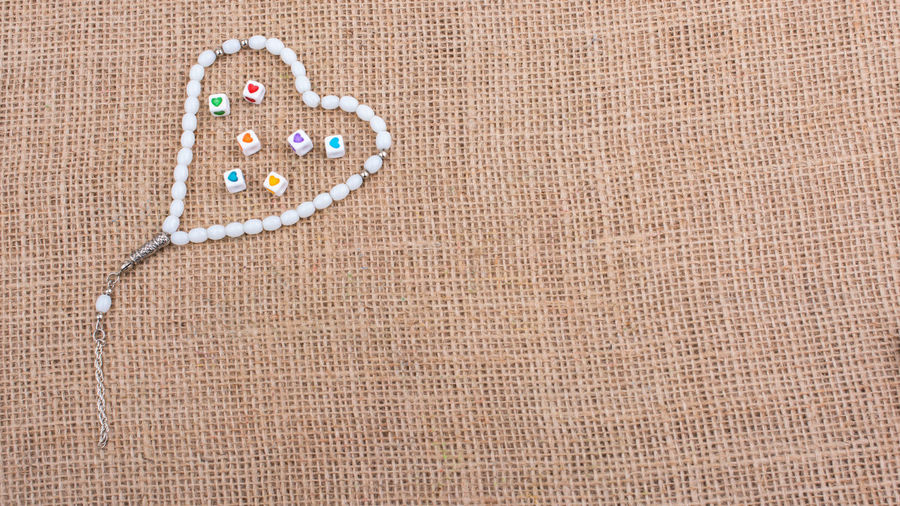 High angle view of necklace on place mat