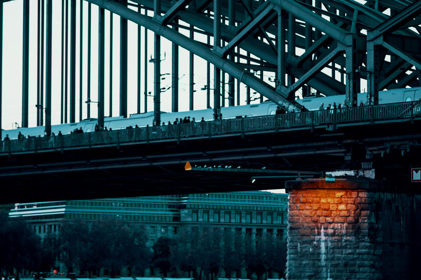 A piece of Sunset Architectural Column Architecture Bridge Bridge - Man Made Structure Building Exterior Built Structure City Connection Day Illuminated Low Angle View Metal Mode Of Transportation Nature No People Outdoors Sunset Transportation Travel Twodayscologne