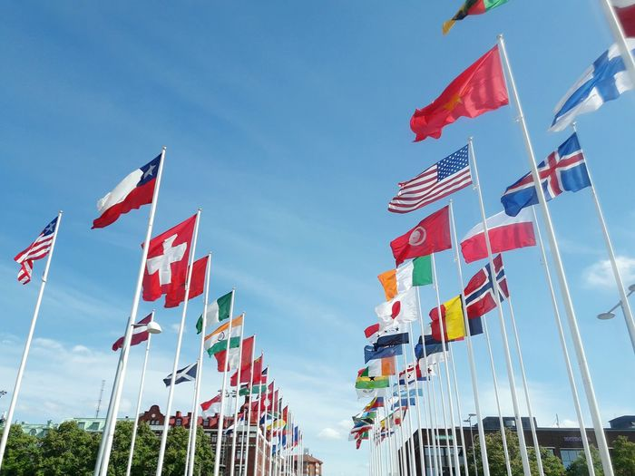 Sky Flag Patriotism Low Angle View Holiday - Event Travel Destinations Countries Countries Of The World Representing Day Outdoors No People Streamer Flags Flags In The Wind  Sweden Heden