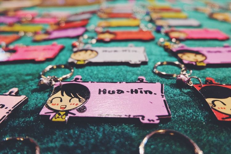 High angle view of key chains with text on table