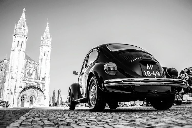 The old and the not-so-new. A Volkswagen Beetle sits near the Museu de Marinha in Lisbon, Portugal. Also seen in the photograph is a facade of the Mosteiro dos Jerónimos ( Jerónimos Monastery ). The Jerónimos Monastery is considered one of the most impressive symbols of Portugal's power and wealth during the Age of Discovery. It houses the tomb of Vasco da Gama. Close to the monastery one can find several other monuments and attractions showcasing Portuguese power and excellence, including the Tower of Belém and numerous museums. Do not forget to try out the delicious bakes at the Pastéis de Belém! Happy exploring :) Lisboa Lisbon Portugal Monastery Beetle EyeEmBestPics Vwbeetle Jeronimos Jeronimos Monastery Vwporn Travel Heritage Vasco Da Gama World History Wide Angle Explore EyeEm Best Shots Eyeem Lisbon Belém Black And White Contrast Historical Place Portugal History Wide Angle View From Below Neighborhood Map