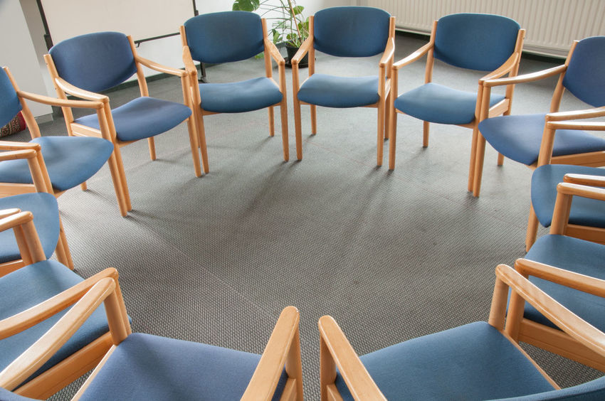 Many blue chairs in the circle Blue Chairs Carpet Chair Day Grey Floor Group Meeting Group Room High Angle View In A Circle In A Row Indoors  No People Psychologist Psychology Seat Table Talking