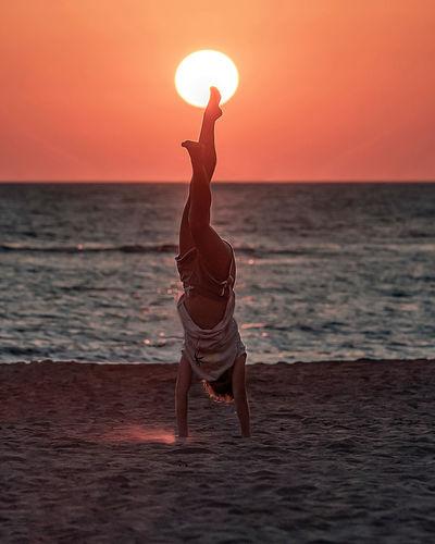 Full length of man on beach during sunset