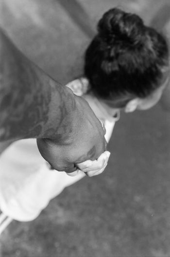 High angle view of man holding hands