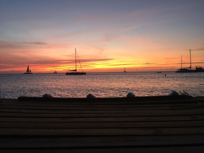 Sunset Sky Water Sea Beauty In Nature Scenics - Nature Cloud - Sky Sailboat Orange Color Nature Mode Of Transportation Horizon Over Water No People Tranquility Silhouette Horizon Nautical Vessel Idyllic Transportation Tranquil Scene