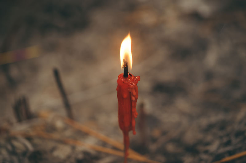 Belief Buddhism Buddhism Culture Burning Candle Close-up Day Fire - Natural Phenomenon Flame Focus On Foreground Glowing Heat - Temperature Illuminated No People Outdoors Pray Red