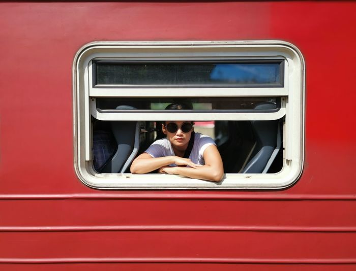 Portrait of woman looking through train window