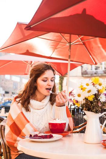 Woman having dessert at restaurant