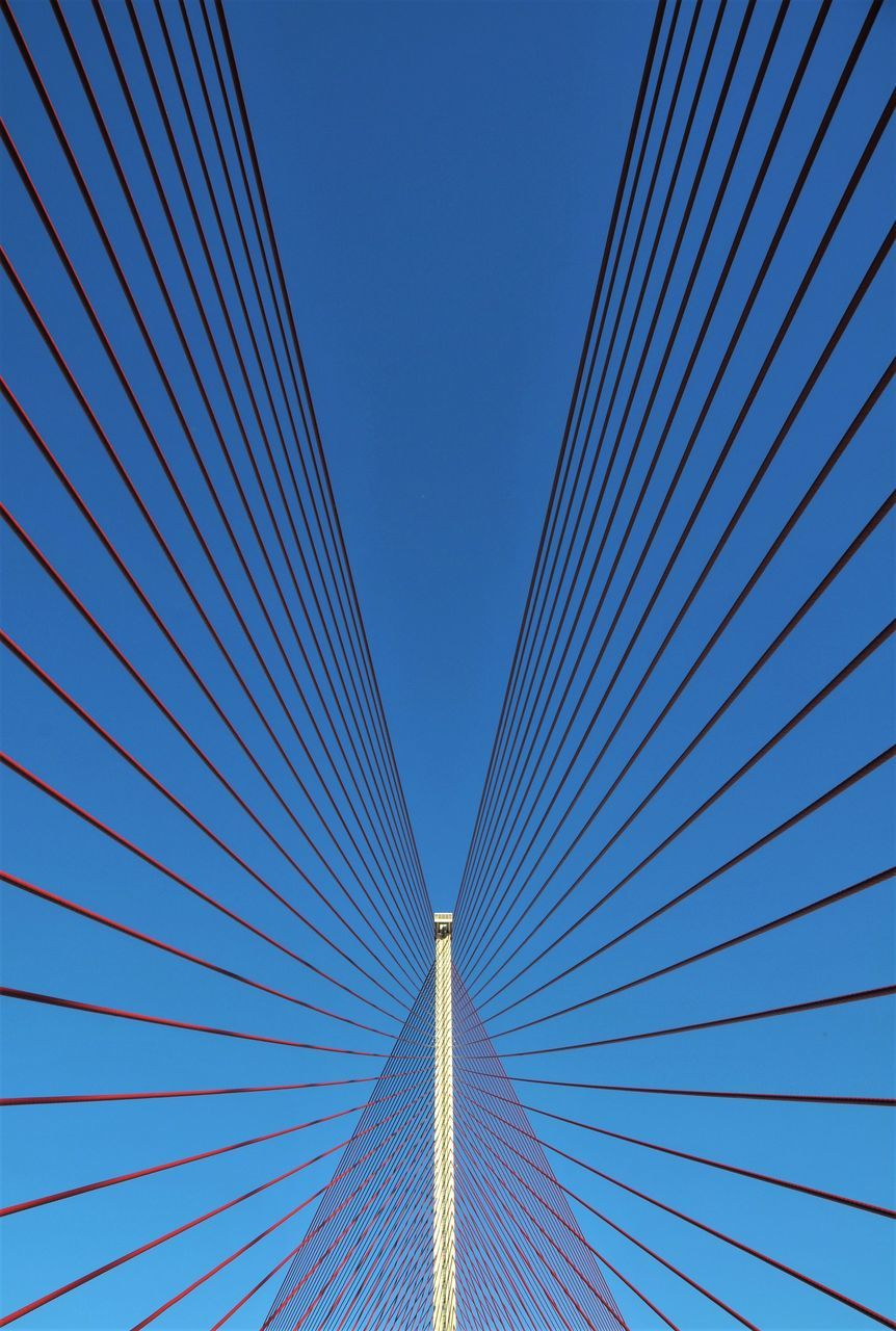 clear sky, blue, no people, low angle view, outdoors, built structure, architecture, day, suspension bridge, cable, modern, sky, line