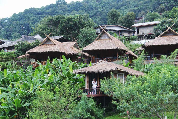 Gazebo by house in village