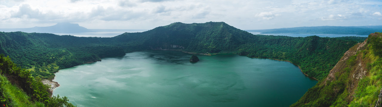 Hiking Taal Lake Taal Volcano Beauty In Nature Day Landscape Mountain Nature No People Outdoors Physical Geography Scenics Sky Tranquil Scene Travel Destinations Water