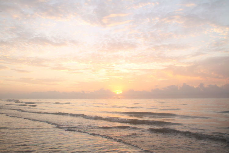 Sunrise at Manggar Beach Sea Water Sunset Sky Scenics - Nature Beauty In Nature Cloud - Sky Tranquility Tranquil Scene Beach Idyllic Nature Horizon Orange Color Horizon Over Water Wave Land No People Motion Sun Outdoors Sunrise Dusk View Landscape