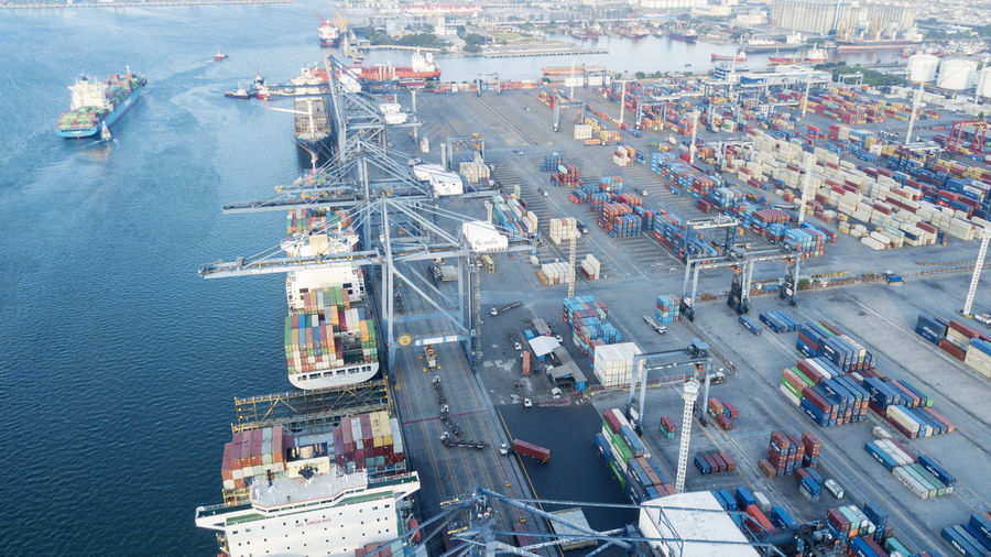 Architecture Business Cargo Container Commercial Dock Container Container Ship Freight Transportation Harbor High Angle View Industry Mode Of Transportation Nature Nautical Vessel No People Outdoors Pier Sea Ship Shipping  Transportation Trucking Water