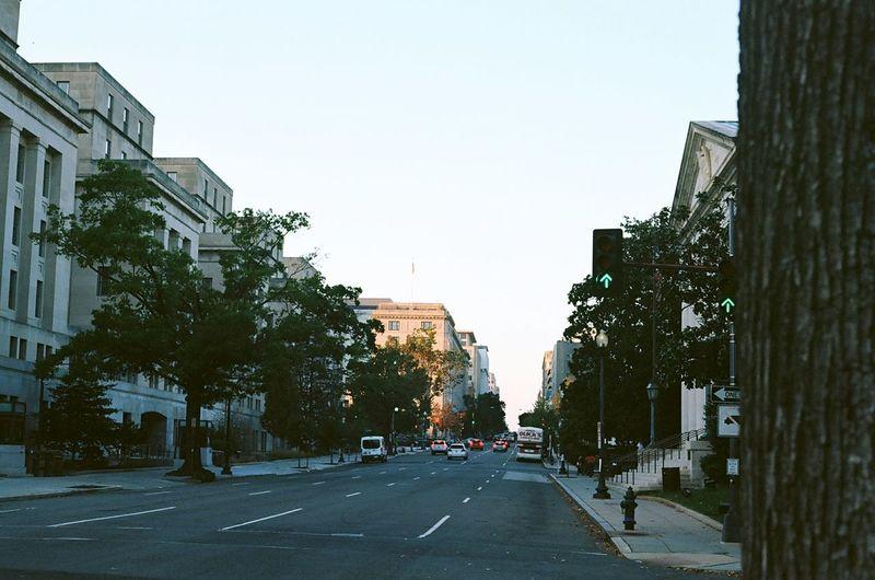 City street amidst buildings against clear sky