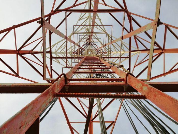 Directly below shot of electricity pylon