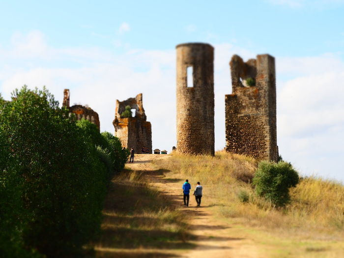 Walking to times of old EyeEm Best Shots Montemor-o-novo Men History Walking Sky Architecture Built Structure Ancient Civilization Old Ruin Castle The Past Archaeology Ancient Fort Ruined
