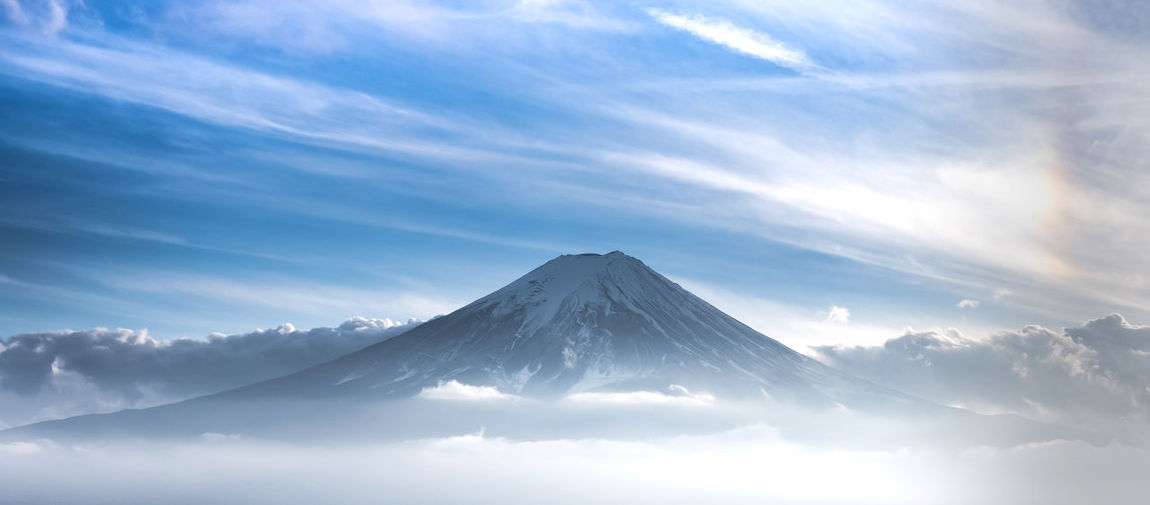 Mountain Fuji in sea of mist or fog at sunrise with cloudy sky, Fujikawaguchiko, Yamanashi, Japan. Sky Scenics - Nature Cloud - Sky Beauty In Nature Mountain Peak Tranquil Scene Tranquility Nature No People Fuji Kawaguchiko Travel Mist Peak Nature Mountain Outdoors Scenics Dawn Sunset Twilight Japan Mount FuJi Landmark Tourist