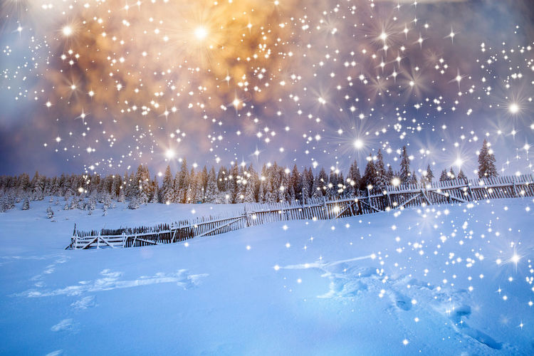 Scenic view of snow covered field against bright sky