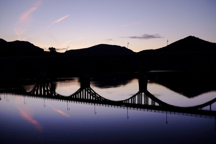 Invisible bridge Bridge Reflection Sky Water Silhouette Sunset Tranquility Tranquil Scene Beauty In Nature Reflection Lake