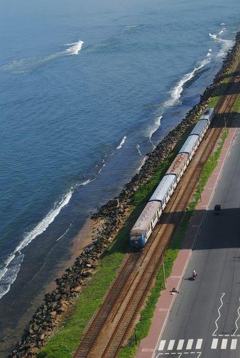 Railway track on beach, Colombo Sri Lanka View From Ozo Hotel Beachbar Ozo Srilanka Colombocity Beach Railway Track Water Sea Beach Road Sand Aerial View High Angle View Car