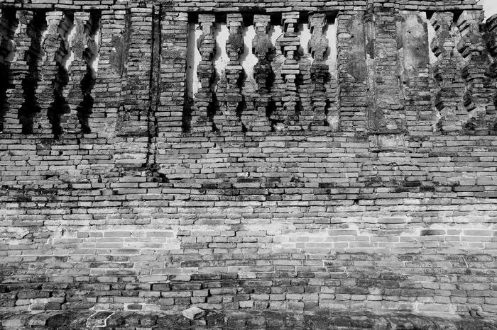 Outdoors Low Angle View Full Frame Built Structure Day Real People Architecture Backgrounds Place Of Worship Low Section Brick Brick Wall Brick Building