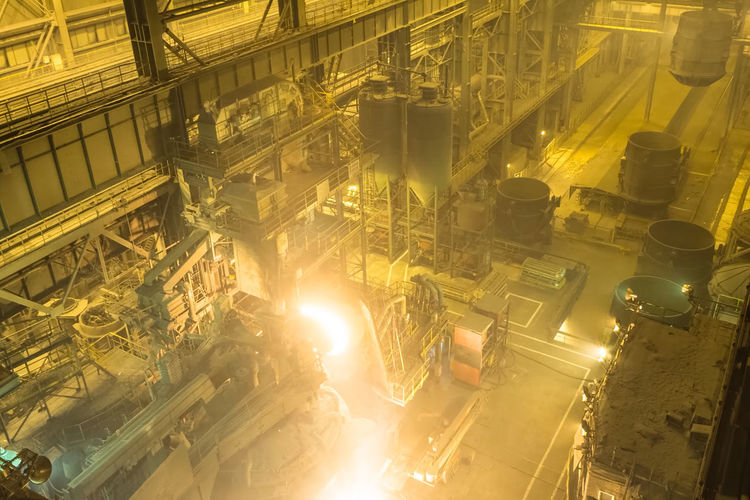 Factory Industry High Angle View Metal Fuel And Power Generation No People Illuminated Business Indoors  Machinery Technology Yellow Complexity Manufacturing Equipment Built Structure Manufacturing Equipment Architecture Glowing Production Line Industrial Equipment Metal Industry