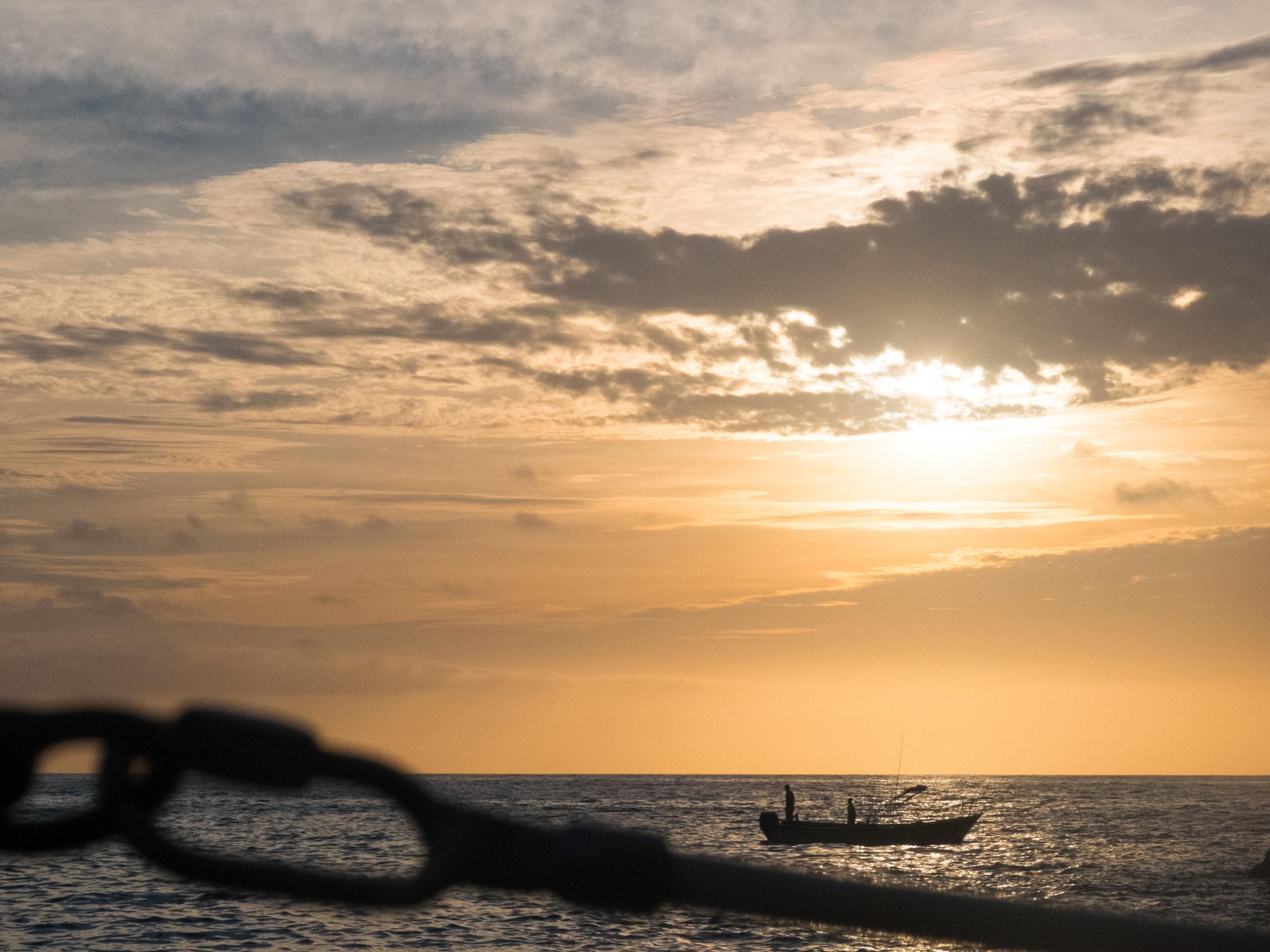 sea, horizon over water, sunset, water, sky, scenics, tranquil scene, beauty in nature, tranquility, beach, nature, orange color, idyllic, cloud - sky, silhouette, shore, sun, cloud, seascape, nautical vessel