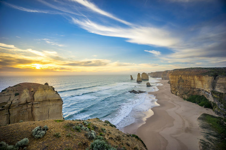Scenic View Of Twelve Apostles Against Sky During Sunset