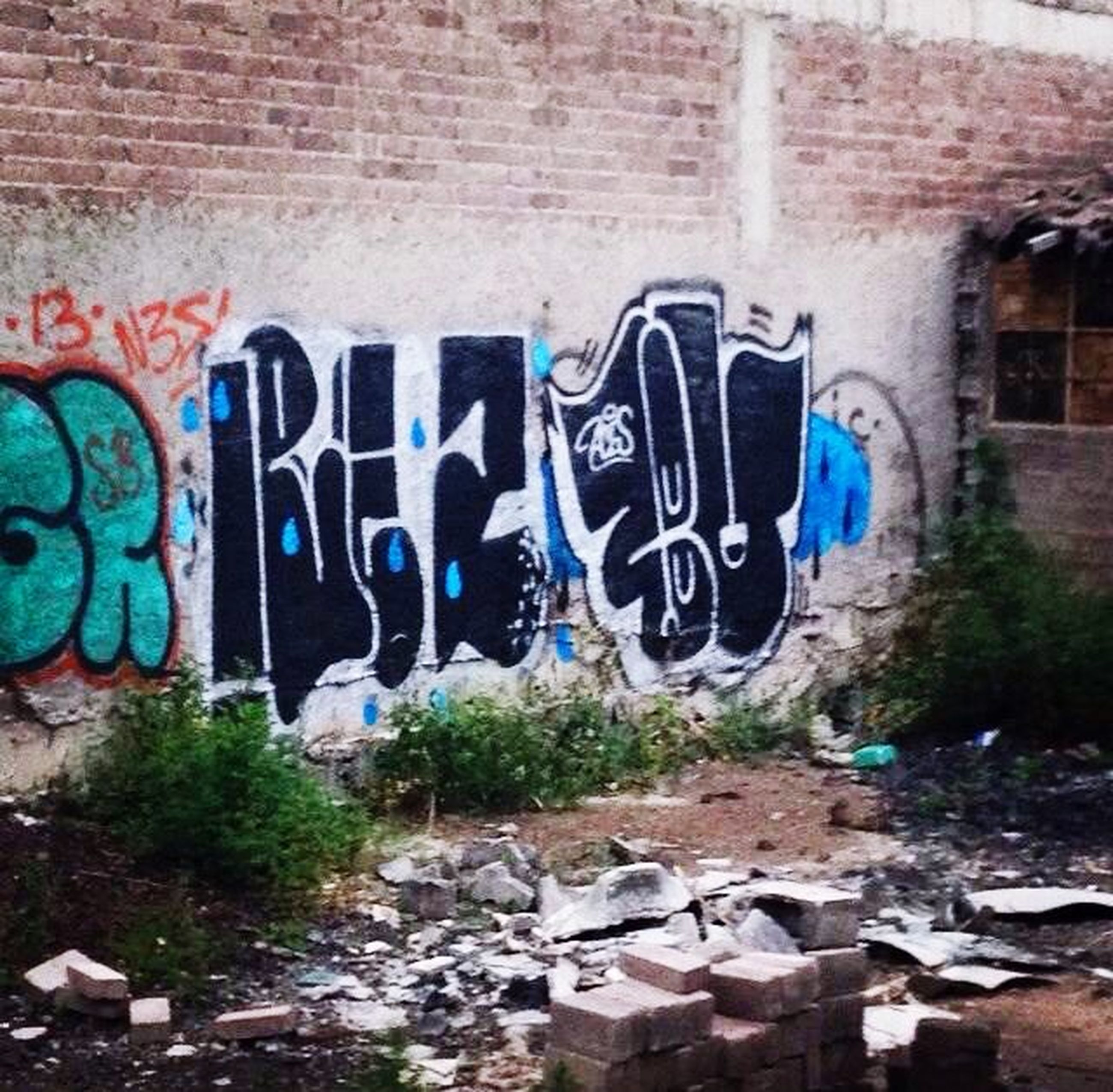 graffiti, art, art and craft, creativity, wall - building feature, built structure, architecture, text, western script, human representation, building exterior, street art, brick wall, wall, multi colored, day, vandalism, communication, weathered, outdoors