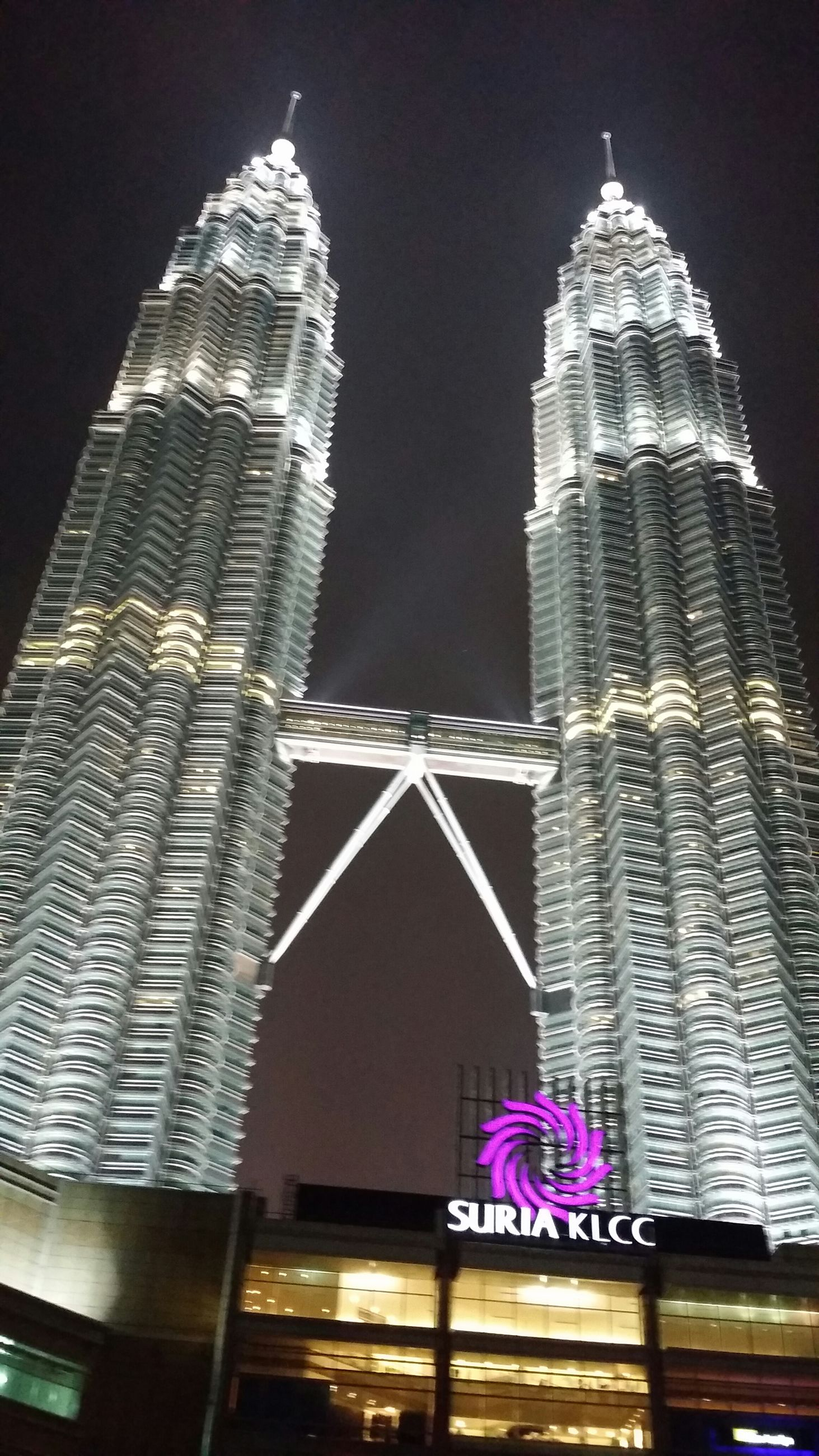 architecture, building exterior, built structure, low angle view, tower, city, tall - high, night, famous place, skyscraper, travel destinations, capital cities, clear sky, international landmark, spire, illuminated, tourism, modern, travel, office building