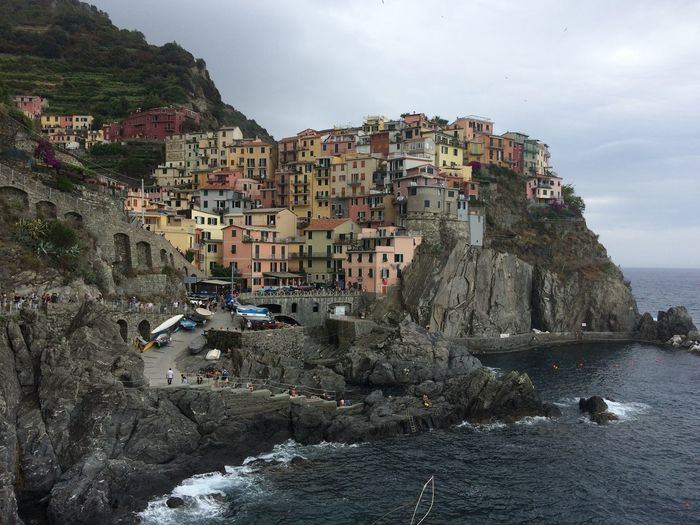 A view of Manarola, Cinque Terre in Italy Cinque Terre Tourist Travel Travelling Architecture Beauty In Nature Building Exterior Built Structure Cliff Day Manarola Mountain Nature Outdoors Rock - Object Rock Formation Scenics Sea Sky Tourism Travel Destinations Water Waterfront