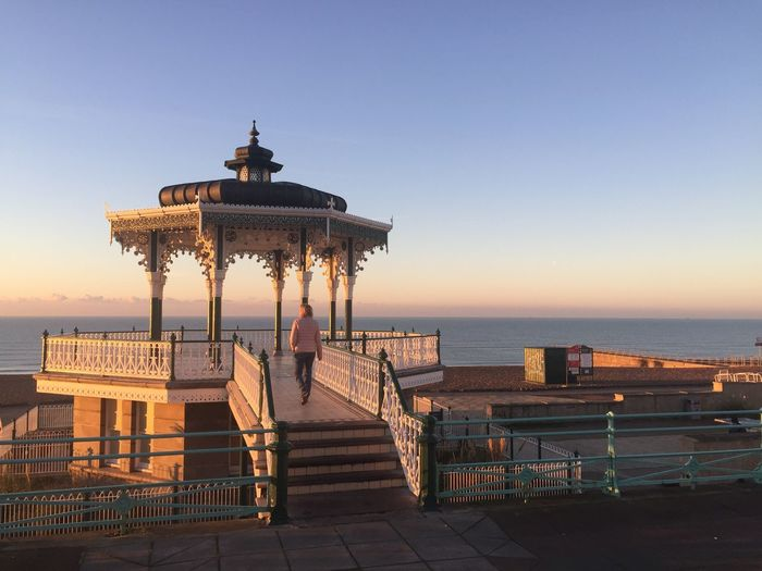 View Of Pier On Sea During Sunset