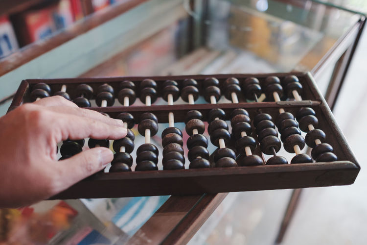 Cropped hand playing abacus