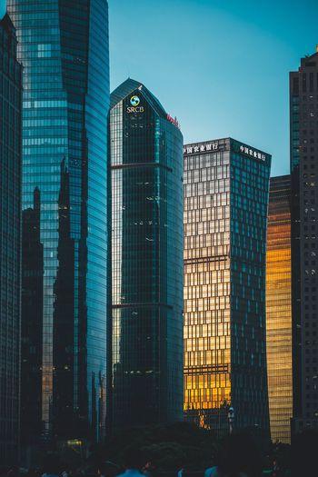 Modern office buildings against blue sky