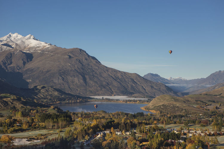 An aerial view of Lake Hayes in autumn. Queenstown, New Zealand. Autumn Autumn Colours Beauty In Nature Hot Air Balloons Lake Lake Hayes Landscape Landscape_Collection Majestic Mountain Mountains New Zealand Outdoors Queenstown Scenic