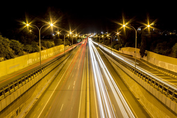 Highway at night Liogiorgio Cyprus Limassol Long Exposure Highway Night Lights Moving Cars Transportation Motion Light Trail Speed Street Road Street Light City Blurred Motion Traffic Direction Multiple Lane Highway Outdoors The Way Forward No People High Angle View