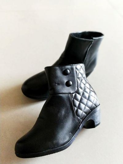 Boots Black Boots Shoe Fashion Clothing Black Color Dress Shoe Indoors  Well-dressed Arts Culture And Entertainment No People Close-up Modern Day Fashion Stories