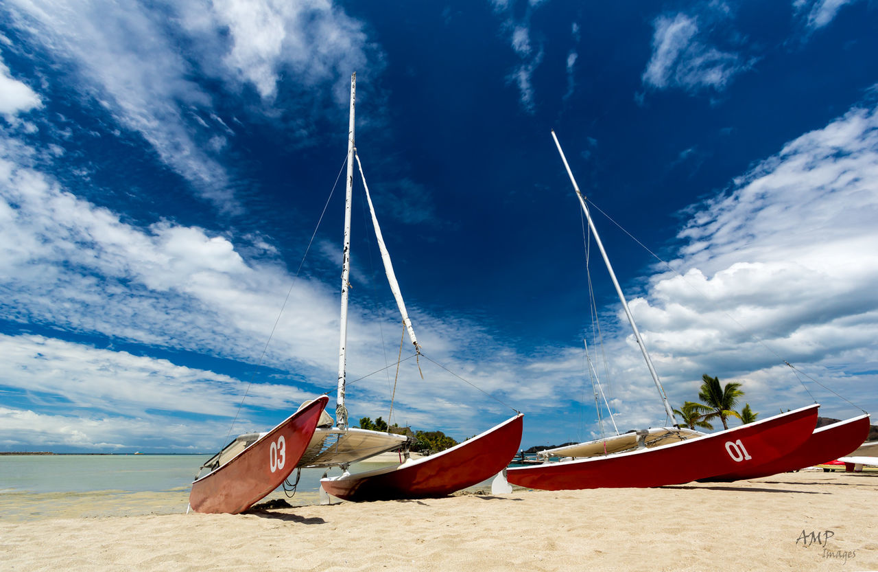 nautical vessel, sky, transportation, cloud - sky, mode of transport, beach, moored, boat, sand, shore, nature, water, sea, beauty in nature, outdoors, tranquil scene, day, tranquility, no people, scenics, longtail boat, outrigger, horizon over water