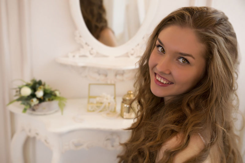 Women Around The World Smiling Portrait Long Hair Only Women Toothy Smile One Woman Only Beauty Beautiful Woman Happiness Adults Only Women Young Women Looking At Camera Indoors  One Young Woman Only Young Adult Headshot Adult One Person People White White Dress Leisure Activity Green Color