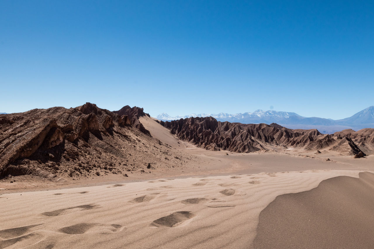 sand, arid climate, desert, nature, scenics, tranquil scene, clear sky, landscape, blue, beauty in nature, sand dune, tranquility, physical geography, copy space, mountain, outdoors, day, no people, sunlight, sky, mountain range