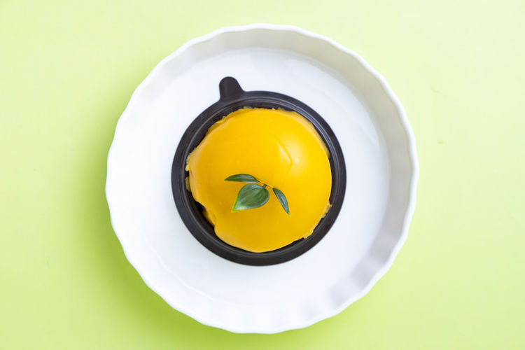 Yellow Directly Above Studio Shot Egg Yolk Indoors  No People Healthy Eating Food High Angle View Food And Drink Plate Egg Freshness Still Life Wellbeing Close-up White Color Cut Out Colored Background Ready-to-eat Temptation Snack