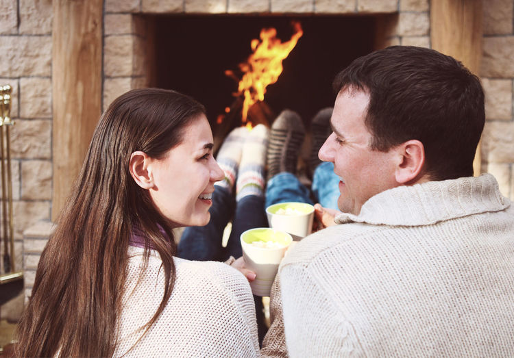 Young couple holding ice cream outdoors
