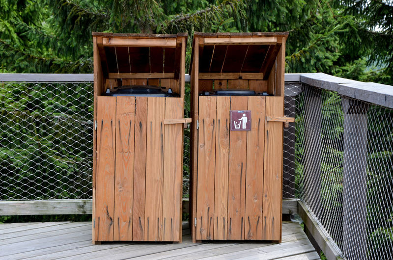 View of wooden trash bins